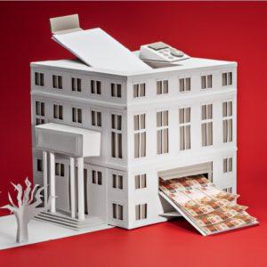 Imagem de um prédio que na verdade é uma impressora de dinheiro.